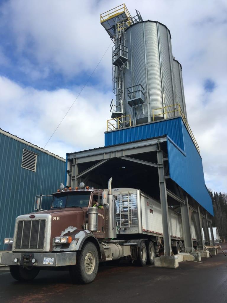 Truck loading Skeena Sawmills pellet plant